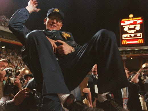 Notre Dame coach Lou Holtz is carried off the field after the Irish secured anational championshipby defeating West Virginia 34-21 in the Fiesta Bowl on Jan. 2, 1988.
