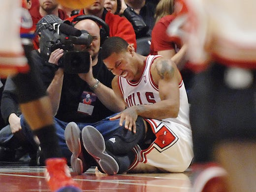The Bulls' Derrick Rose collapses to the floor in Game 1 of an NBA playoff game against the Philadelphia 76ers on April 28, 2012.