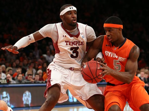 Syracuse Orange forward C.J. Fair (5) drives to the net as Temple Owls forward Anthony Lee (3) defends during the first half at Madison Square Garden.Temple upset No. 3 Syracuse 83-79.