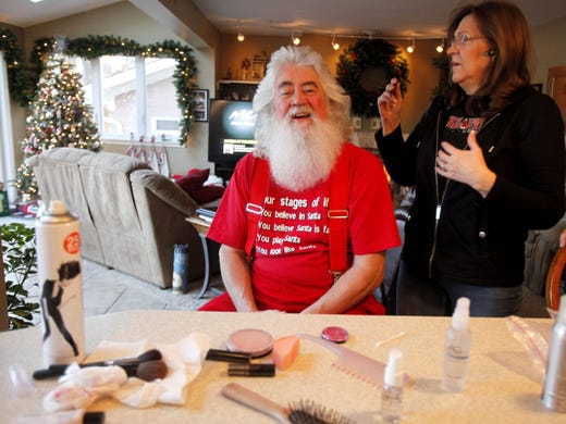 At his home in Waterford, Mich., Santa Bob Garrison, a professional Santa's helper, and his wife, Jacque, start his grooming before a school visit.