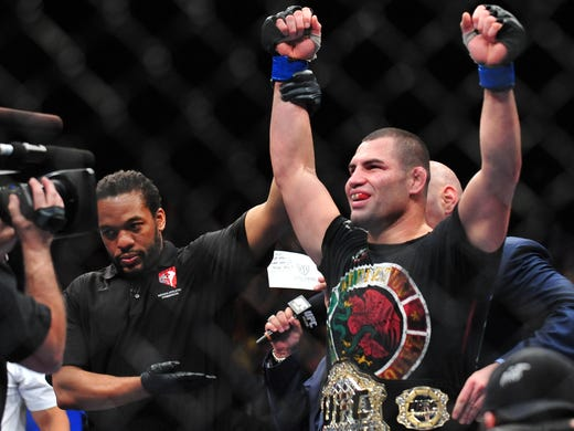 Cain Velasquez (right) regains the UFC heavyweight championship from Junior Dos Santos during UFC 155 at the MGM Grand Garden Arena.