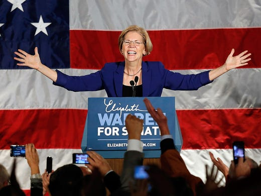 Elizabeth Warren takes the stage after defeating incumbent Republican Sen. Scott Brown on Nov. 6 at the Fairmont Copley Plaza Hotel in Boston.