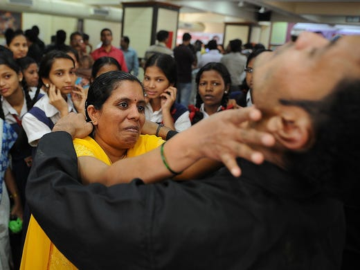A woman practices a self-defense move with an instructor on Jan. 4 in Mumbai, India. Women are leading a surge of interest in self-defense classes after the horrifying gang rape and death of a 23-year-old university student in New Delhi.