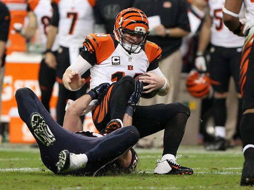 Bengals quarterback Andy Dalton (14) is tackled by Texans outside linebacker Brooks Reed (58) during the fourth quarter.