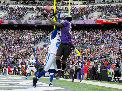 Baltimore Ravens wide receiver Anquan Boldin (81) catches an 18-yard touchdown pass over Indianapolis Colts cornerback Darius Butler (20) during the fourth quarter of the AFC Wild Card playoff game at M&T Bank Stadium.The Ravens defeated the Colts 24-9.