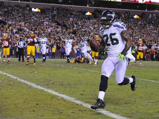 Seattle Seahawks fullback Michael Robinson (26) scores a touchdown against the Washington Redskins during the second quarter of the NFC Wild Card playoff game at FedEx Field.