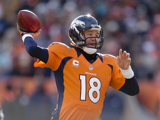 Denver Broncos quarterback Peyton Manning was selected by the Indianapolis Colts with the first pick in the 1998 draft.