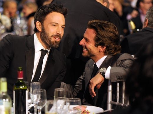 'Argo' director and co-star Ben Affleck chats with 'Silver Linings Playbook' star Bradley Cooper at the Critics' Choice Movie Awards on Thursday.  Affleck won best director and 'Argo' won best film.