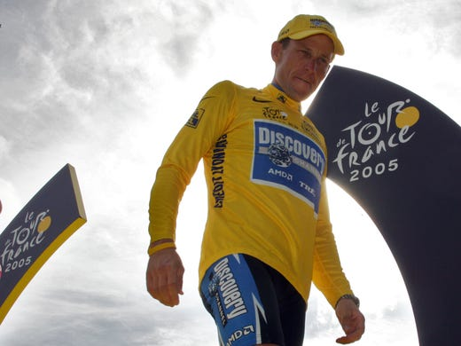 Lance Armstrong stands on the winners' podium after the 21st stage of the 92nd Tour de France in 2005.