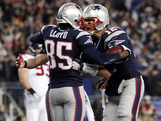 New England Patriots wide receiver Brandon Lloyd (85) celebrates after catching a touchdown pass from quarterback Tom Brady (12) during the second half of the AFC divisional playoff game against the Houston Texans at Gillette Stadium.