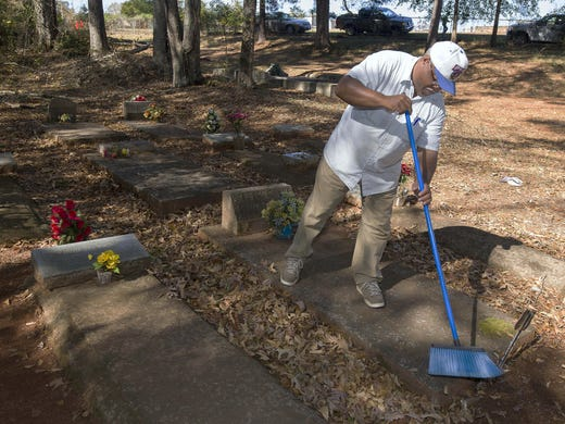 Veteran Whitley Culverson, part of a group of volunteers from VFW Post 10558, helps clear the African-American section of Hamilton City Cemetery in Hamilton, Ga.