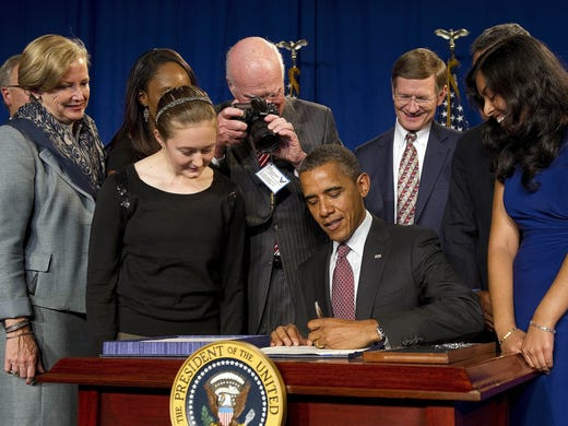 Sen. Patrick Leahy, D-Vt., photographs President Obama as he signs the America Invents Act, on Sept. 16, 2011. Leahy, the most senior member of the Senate, is an avid photographer whose 38 years in Washington have given him unique access and perspective through his camera lens.