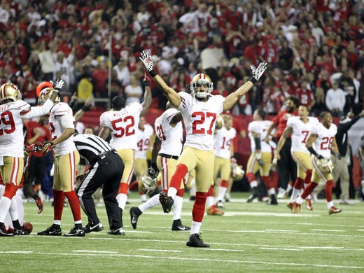 San Francisco 49ers defensive back C.J. Spillman (27) celebrates after defeating the Atlanta Falcons in the NFC Championship game at the Georgia Dome. The 49ers defeated the Falcons 28-24.