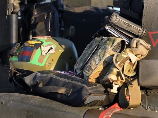Prince Harry's crash helmet and personnel kit at the side of the cockpit of his Apache helicopter close to the flight-line at Camp Bastion in Afghanistan's Helmand Province, where he served as an Apache Helicopter Pilot/Gunner with 662 Sqd Army Air Corps. Prince Harry completed his tour of duty on Monday.