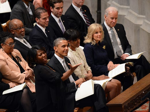 President Obama, first lady Michelle Obama,  Jill Biden and her husband, Vice President Biden, listen to the choir during the National Prayer Service on Jan. 22 at the National Cathedral in Washington, D.C.
