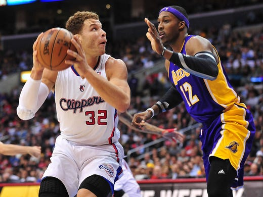 Lakers center Dwight Howard, right, must be waving at Clippers forward Blake Griffin, his fellow All-Star. Flip through this gallery for the full Western Conference roster.