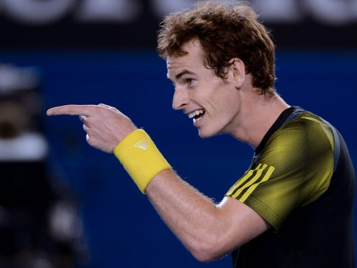 Andy Murray flashes a smile on his way to a  6-4, 6-7 (5-7), 6-3, 6-7 (2-7), 6-2 victory against Roger Federer, sending Murray to the Australian Open final. It was his first victory against Federer in a Grand Slam.
