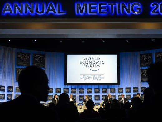 Participants listen to a panel session Jan. 26, the last day of  the 43rd Annual Meeting of the World Economic Forum, in Davos, Switzerland.