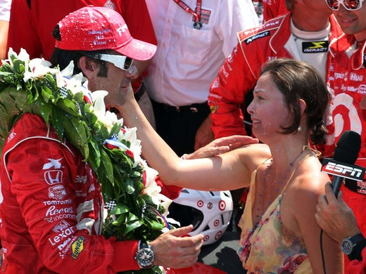 IndyCar driver Dario Franchitti celebrates in victory lane with wife Ashley Judd after winning the 2012 Indianapolis 500 at the Indianapolis Motor Speedway. The couple say they splitting after 11 years of marriage.