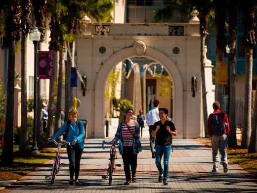 """Students walk through campus at New College of Florida in Sarasota, which has been named a """"best value"""" college by Princeton Review every year for the last five years."""
