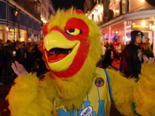 A man dressed as a chicken wearing a New Orleans Hornets uniform on Bourbon Street on Friday night.
