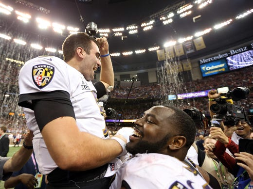 Baltimore Ravens quarterback Joe Flacco is hoisted by his teammates after defeating the Baltimore Ravens in Super Bowl XLVII at the Mercedes-Benz Superdome.