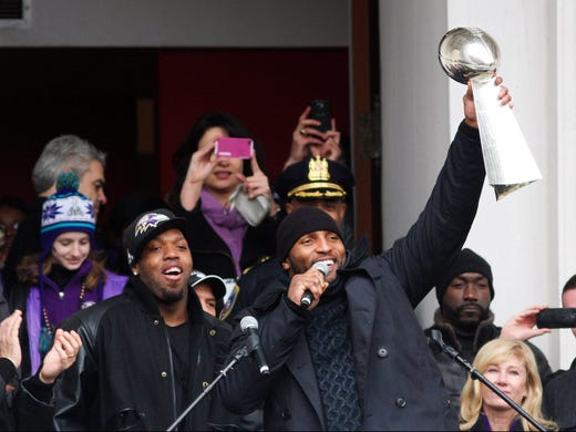 Baltimore Ravens inside linebacker Ray Lewis hoists the Vince Lombardi Trophy during the Baltimore Ravens victory parade.