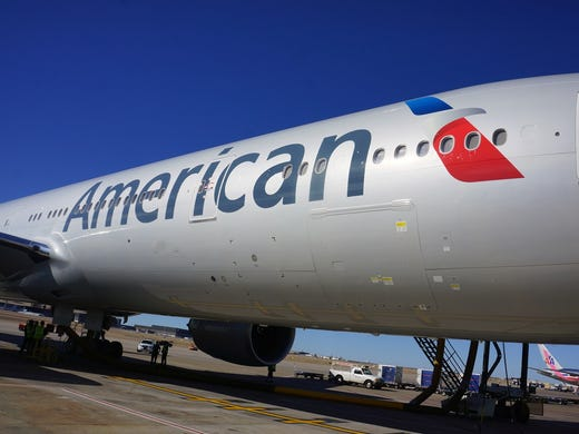 Seen here in Dallas/Fort Worth on Jan. 31 prior to its inaugural flight to Sao Paolo, this Boeing 777-300ER was the first plane to fly paying passengers in American Airlines' new paint scheme.