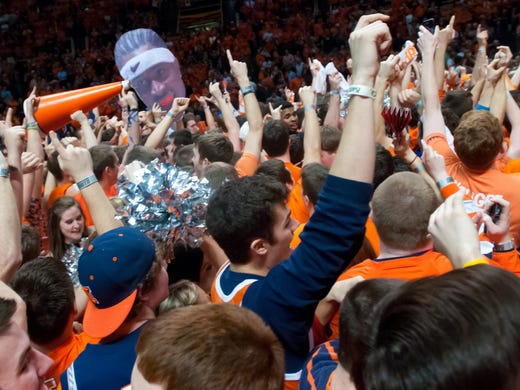 Illinois Fighting Illini fans celebrate after Illini defeated top ranked Indiana Hoosiers 74-72 at Assembly Hall.