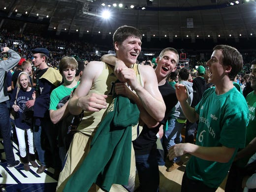 When it was finally over in South Bend, Ind., Jack Cooley, center, and Notre Dame held off Big East rival Louisville 104-101 in the longest game of the college basketball season thus far.