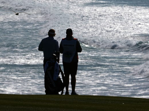 Brandt Snedeker and caddie Scott Vail wait on the eighth hole. Fortunately, there is a nice view.