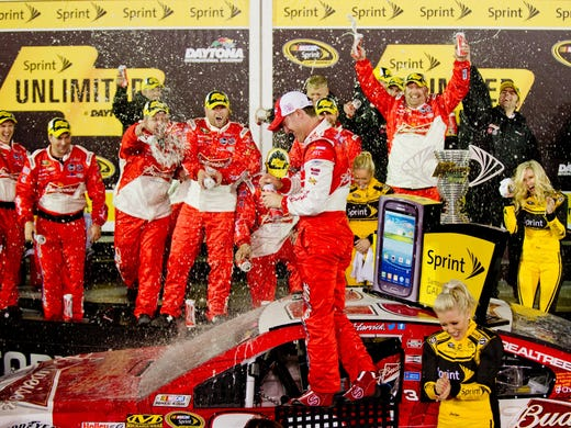 Kevin Harvick celebrates with his crew after winning the Sprint Unlimited Saturday at Daytona International Speedway. It was the third time Harvick won the event formerly known as the Budweiser Shootout.