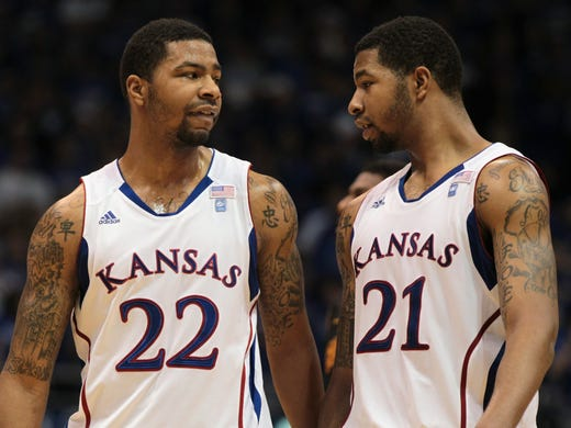 Marcus Morris, left, and Markieff Morris played together for three years on the Kansas Jayhawks. They'll be reunited as teammates on the Phoenix Suns. There is a long history of sports siblings.