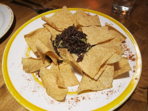 Zocalito''s chef-owner imports many special ingredients from Mexico''s Oaxaca region, including the fried grasshoppers that top this plate of chips and guacamole.