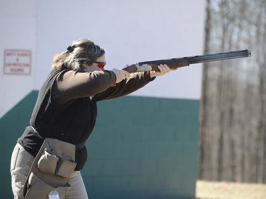 Christine Fox shoots a round of skeet at the West Virginia Sportsmen & Firearms shooting range on Feb. 12 in Fairmont, W.Va. In rural West Virginia, a state that has more than two dozen publicly owned shooting ranges, guns are as much a way of life as pickups and small-town cafes.