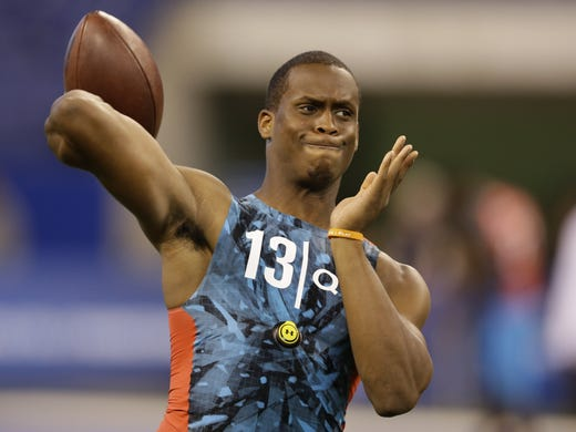 West Virginia quarterback Geno Smith runs a drill at the NFL football scouting combine in Indianapolis, Sunday, Feb. 24, 2013.