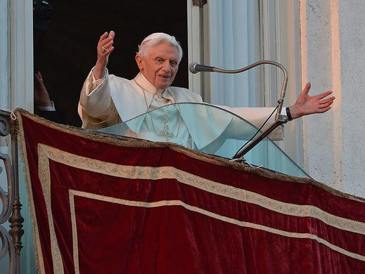 Pope Benedict XVI waves to the crowd from a balcony at Castel Gandolfo, Italy.The pontiff became the first pope in 600 years to retire as leader of the Catholic Church.