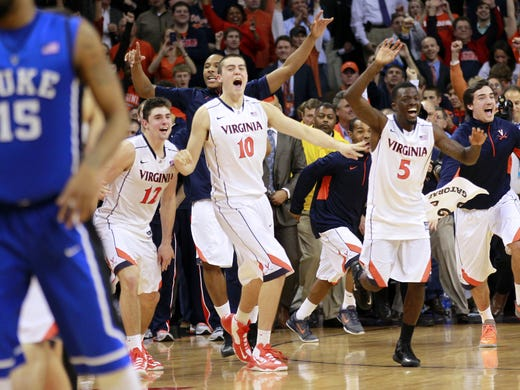 Virginia Cavaliers players celebrate after their game against the Duke Blue Devils at John Paul Jones Arena.