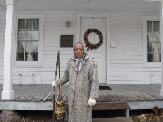 Pauline Copes-Johnson, 85, Harriet Tubman's great-grandniece and lifelong Auburn resident, stands in front of the home for the aged once run by Tubman.