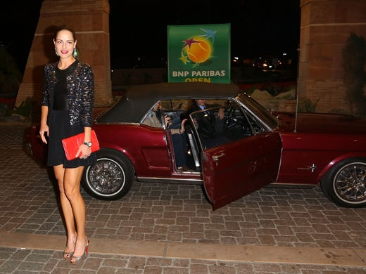 Ana Ivanovic of Serbia arrives for the players' party for the BNP Paribas Open on Thursday night at the IW Club in Indian Wells, Calif. A tradition in tennis, the player's party, where the game's best get all dressed up.