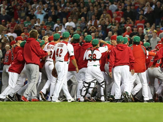 Mexico players fight with Canada players in the ninth inning of the World Baseball Classic.