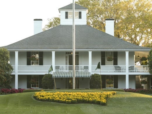 The Augusta National Clubhouse  was initially constructed in 1854 by the owner of the then indigo plantation, Dennis Redmond, and is considered the first cement house constructed in the South. The Masters Club Room is on the second floor left of the flagpole. The Crow's Nest is at the top.
