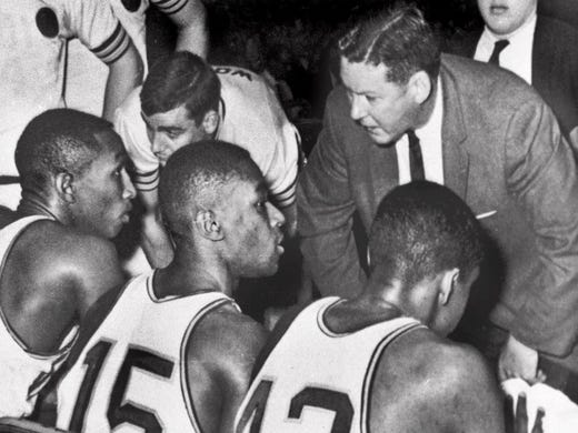 Loyola-Chicago coach George Ireland, right, instructs his players during the NCAA championship game in 1963.
