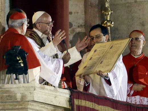 Pope Francis speaks from the central balcony of St. Peter's Basilica at the Vatican.