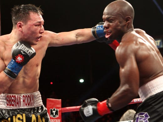 Ruslan Provodnikov lands a left to Timothy Bradley during the 12th round Saturday night.