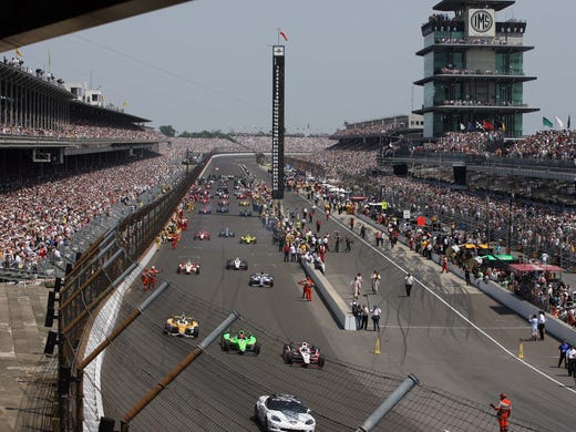 Ryan Briscoe leads the field as they leave the grid for the start of the 2012 Indianapolis 500. Dario Franchitti went on to win the race.