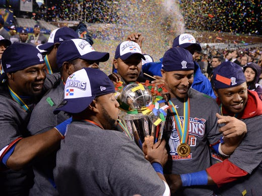 Dominican Republic celebrates winning the World Baseball Classic championship after winning against Puerto Rico at AT&T Park. Dominican Republic won 3-0.
