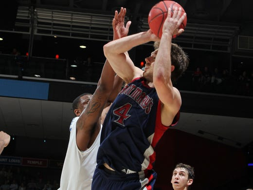 St. Mary's Gaels guard Matthew Dellavedova takes a shot against the Middle Tennessee Blue Raiders during the first round at University of Dayton Arena.