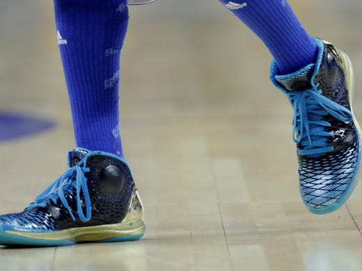 UCLA's Larry Drew II's shoes from the Bruins' second-round game against Minnesota in Austin, Texas. Minnesota won 83-63.