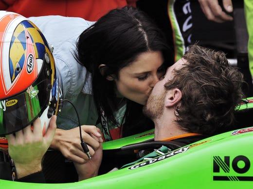 James Hinchcliffe kisses his girlfriend Kirsten Dee after winningthe season-opening Honda Grand Prix of St. Petersburg on Sunday.